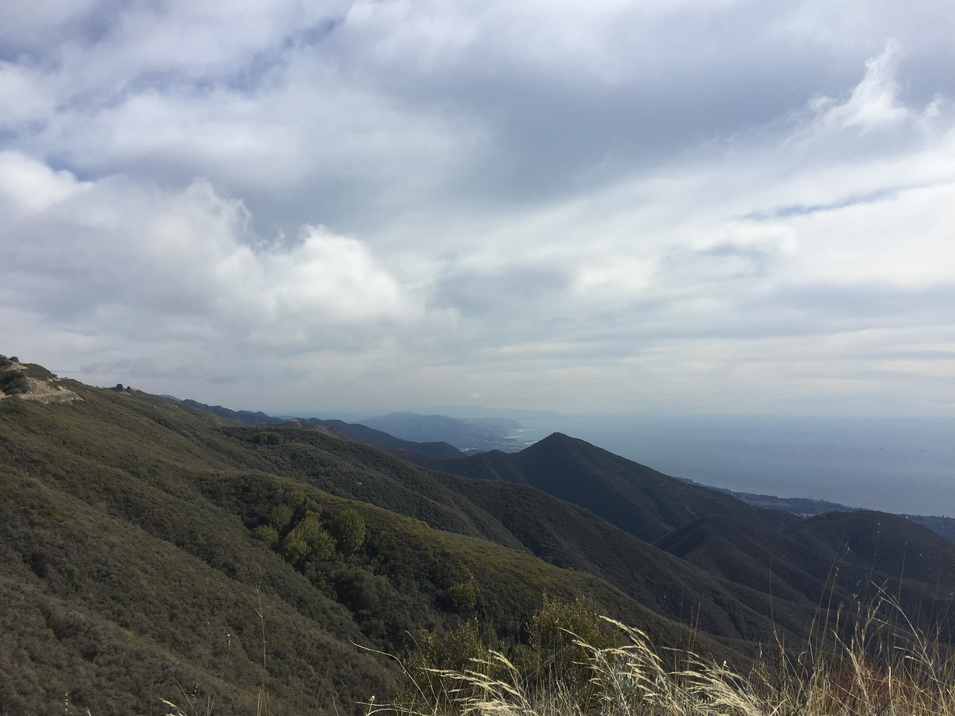 Clouds over the Montecito hills with ocean in bacground