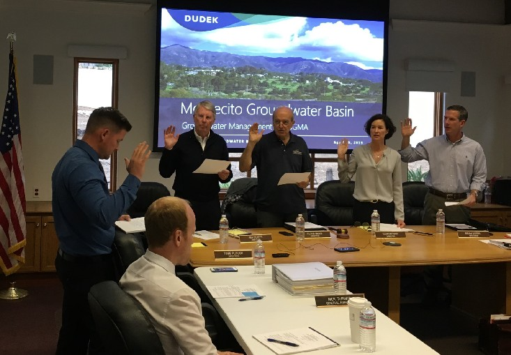 General Manager of the Montecito Water District Nick Turner leads the oath of office for Directors Ken Coates, Floyd Wicks, Cori Hayman, and Brian Goebel (left to right). Director Tobe Plough was absent. Seated in front is Adam Kanold, Engineering Manager for Montecito Water District.